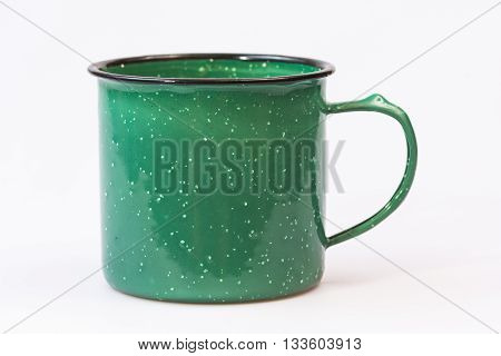 Vintage green stoneware coffee mug on white