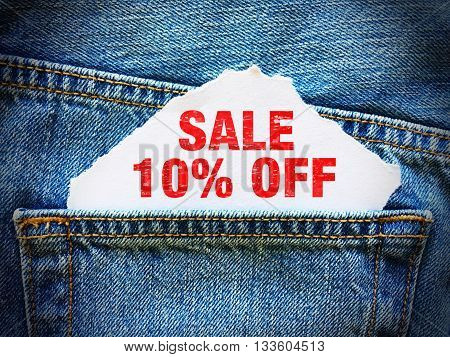 10% off on white paper in the pocket of blue denim jeans
