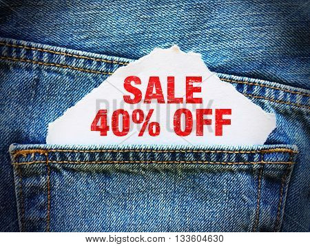 40% off on white paper in the pocket of blue denim jeans