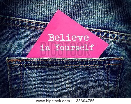 Believe in yourself word on jeans background