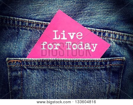 Live for today word on jeans background
