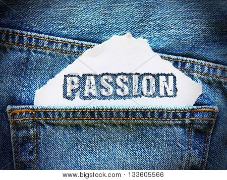 passion word on white paper in the pocket of blue denim jeans