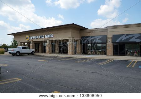 SHOREWOOD, ILLINOIS / UNITED STATES - AUGUST 16, 2015: One may eat chicken wings at the Buffalo Wild Wings restaurant in a Shorewood strip mall.
