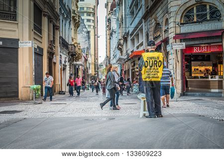 Sao Paulo - April 30, 2016 -  Man Wear Signs Advertisement On The Corner At Patriarca Street And Qui