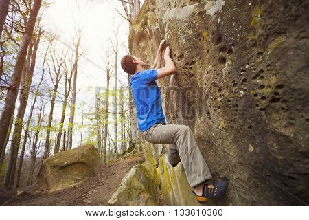 Climber Is Bouldering On The Rocks.