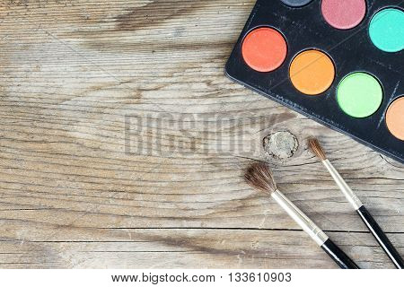 Close-up Of Watercolors And Brushes On Wooden Background