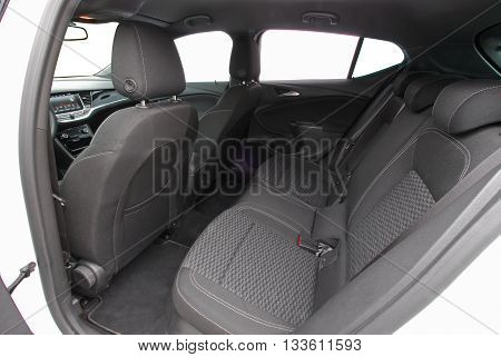 car interior, black rear seat in the passenger car