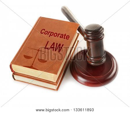 Gavel and books isolated on white. Corporate Law concept
