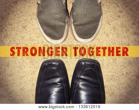 Men shoes with words Stronger Together business concept