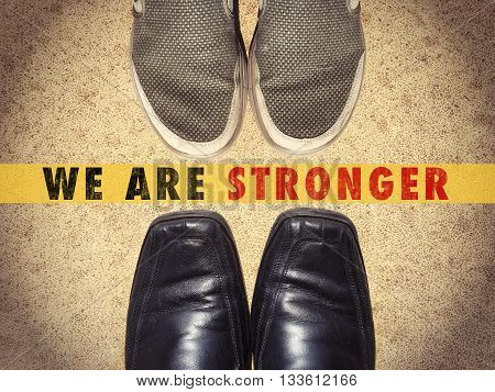 Men shoes with words We are stronger