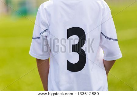 Sport t shirt. Young sport player closeup on sport uniform. Sport stadium in the background.