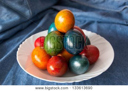 Easter eggs in all colors decorated with children's hand