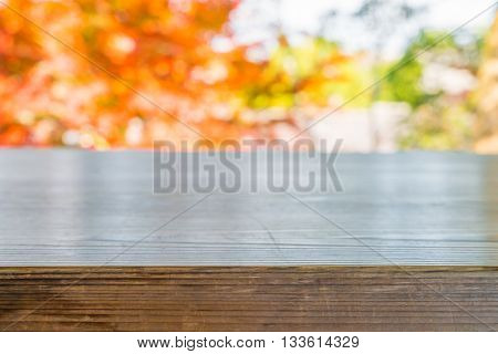 Wood floor with Autumn Leaves , Summer time