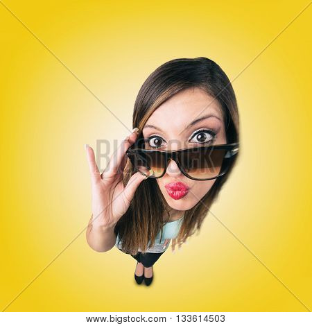 Funny Kissing Girl with eye wear looks like caricature of herself fish eye lens shot