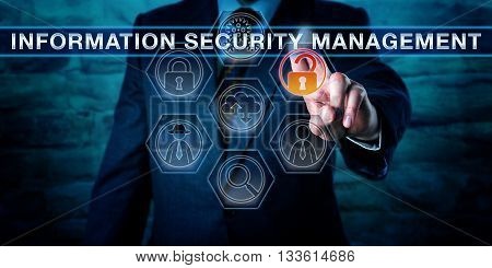Male corporate manager is touching INFORMATION SECURITY MANAGEMENT on an interactive control screen displaying virtual forensics tool icons. Cyber security concept and business metaphor for ISM.