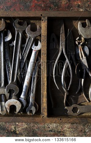 Loads Spanners And Tongs On A Colorful Wooden Background