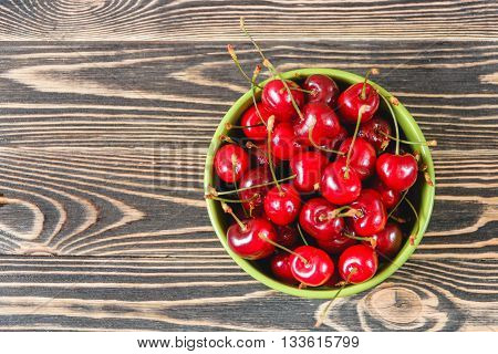 Red Cherries in the Green Cup on Wooden Table, Fruits, Berries Healthy Food Concept