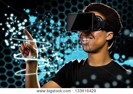 Man wearing a Virtual Reality headset and watching light paintings