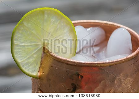 Moscow mule lime on a hammered copper mug with ice