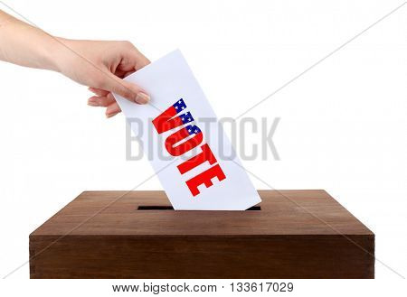 Human hand inserting bulletin in ballot box isolated on white