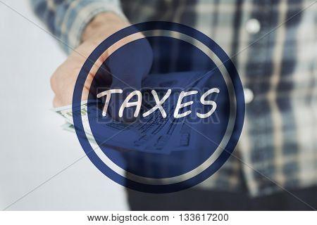 Man paying taxes.Taxes concept
