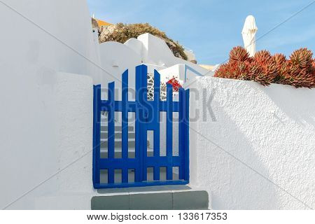 Traditional narrow street in the town Fira on the island of Santorini, Greece.