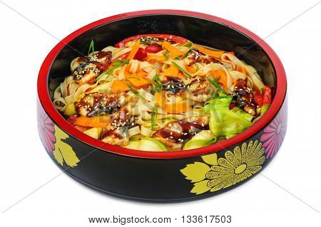 tagliatelle pasta with smoked eel and vegetables in black bowl isolated on white