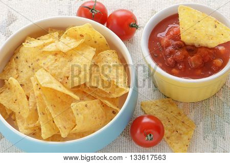 Organic corn chips with fresh home made salsa in horizontal format