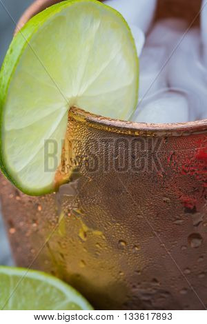 Close up of lime in a copper mug