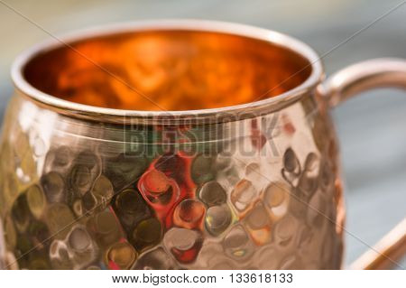 Close up of hammered copper mug top