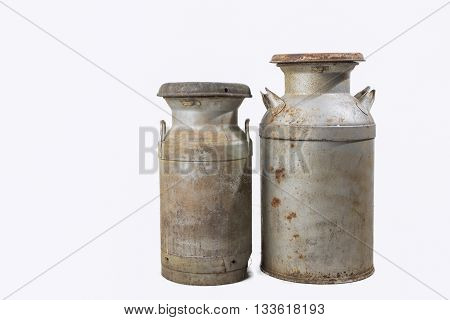 Old rusty milk cans with white background