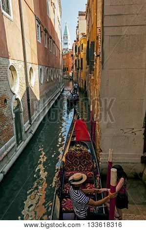 Venice, Italy - September 7, 2012: Gondolas, famous boats of Venice on the one of its Canals