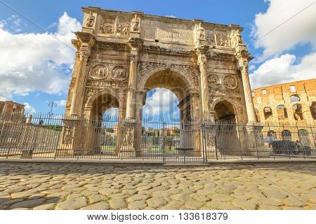 The spectacular Arch of Constantine at sunset, located between the Colosseum and the Arch of Titus on the Roman road, built to celebrate the triumph of the emperor Constantine. Rome, Lazio, Italy.