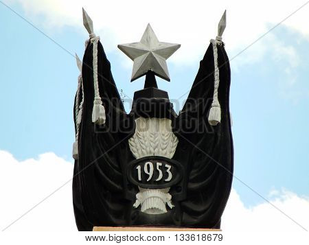 KHARKIV, UKRAINE, HOLODNOGORSKIY OVERPASS - SEPTEMBER 16: Memorable cast metal sculpture and the pylon is devoted to mourning in the year of Stalin's death - 1953. Elements of Soviet symbols - star, flags, ears of wheat.