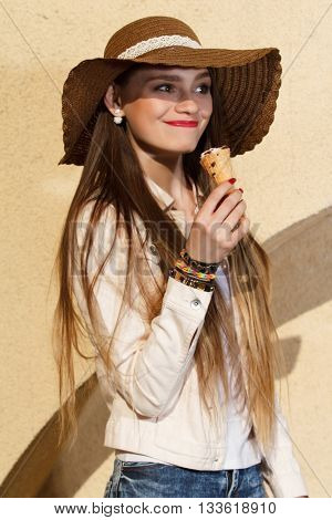 girl in the hat eating ice cream