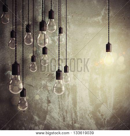 Shiny lit light bulb among unlit bulbs 3d rendering