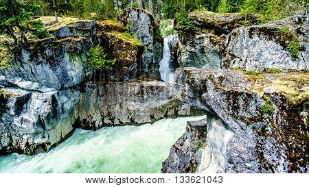 Water of the Lillooet Rives is cascading down the Nairn Falls in Nairn Falls Provincial Park in British Columbia