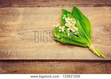 Bouquet Of Lilies Of The Valley On The Wooden Background. Spring Background. Summer Background