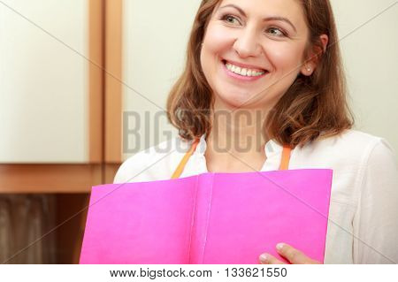 Housewife With Cookbook In Kitchen.