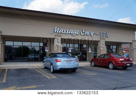 SHOREWOOD, ILLINOIS / UNITED STATES - AUGUST 16, 2015: One may enjoy a massage at Massage Envy, in a strip mall in Shorewood.
