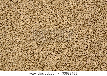 Background texture of dried yeast used in baking.