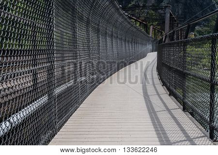 Overly Protected Walkway next to railroad bridge