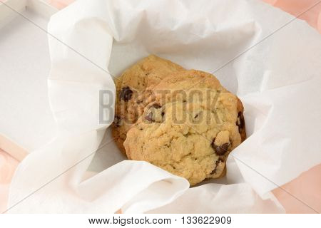 Care package of chocolate chop cookies in box and tissue paper