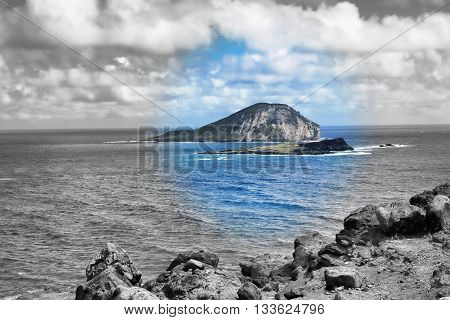 Blue Oahu Hawaii with remote Island in view.