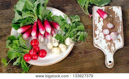 Bundle Of Organic Radishes On  Rustic Table.