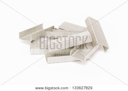 Stack of metal staples isolated on white background
