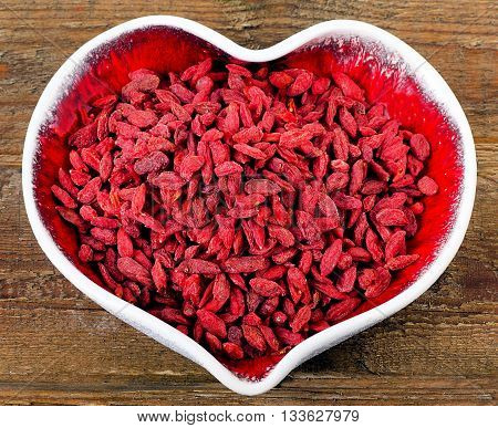 Goji Berries In A Heart Shape Bowl.