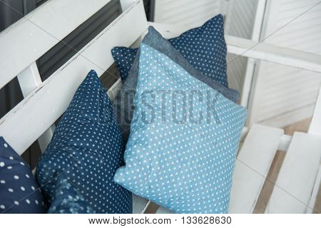 Close-up Of Blue Cushions Lie On A Wooden