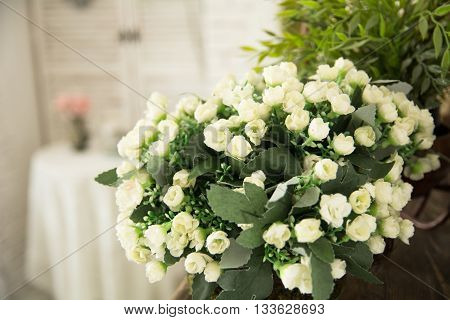 Vase With White Small Flowers In The Interio