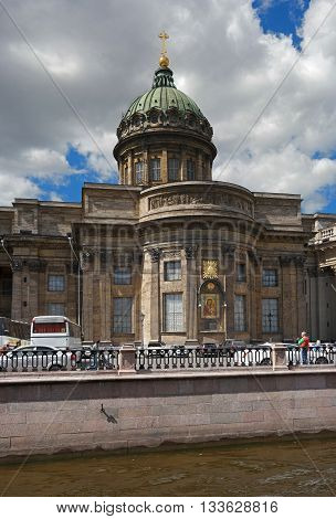 St. Petersburg Russia - June 4 2016: 2016: Kazan Cathedral -Cathedral of the Kazan Icon of the Mother of God-. In the foreground sightseeing buses.
